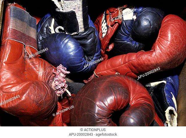Close up of several boxing gloves