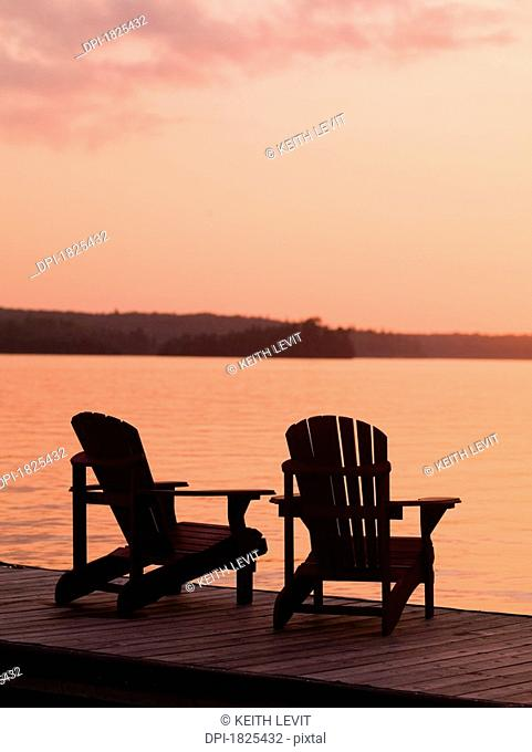 Adirondack chair silhouette Stock Photos and Images ...
