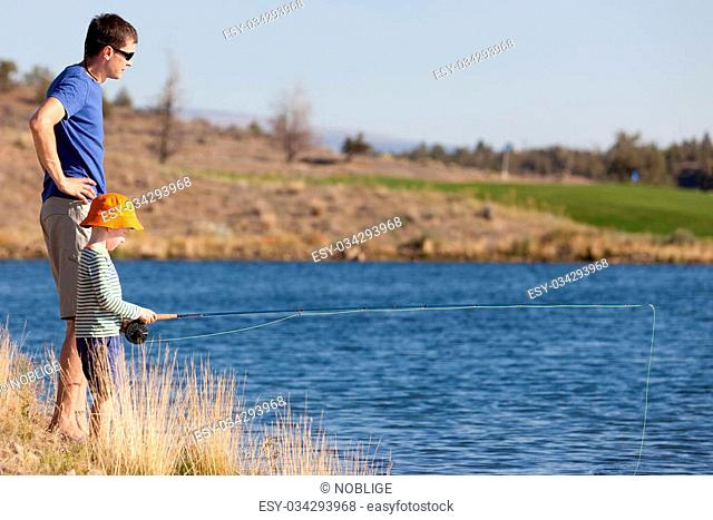 young father teaching his cute son fishing