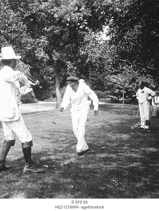 Bampton Morris Dancers, Oxfordshire, Whit Monday, 5 June 1911. William Nathan Wells playing the fiddle, Charles Tanner dancing