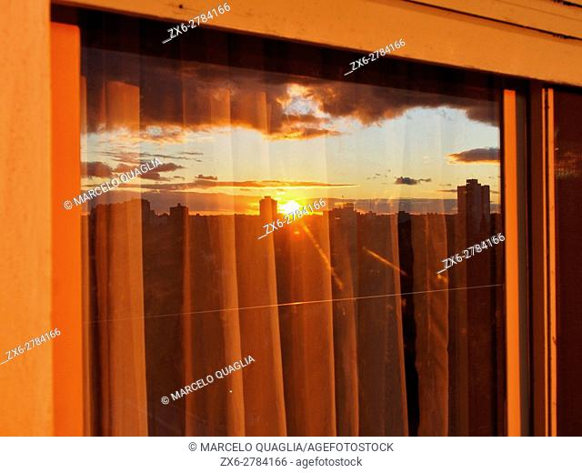 Window reflection. Sunset at Buenos Aires Metropolitan Area, Argentina