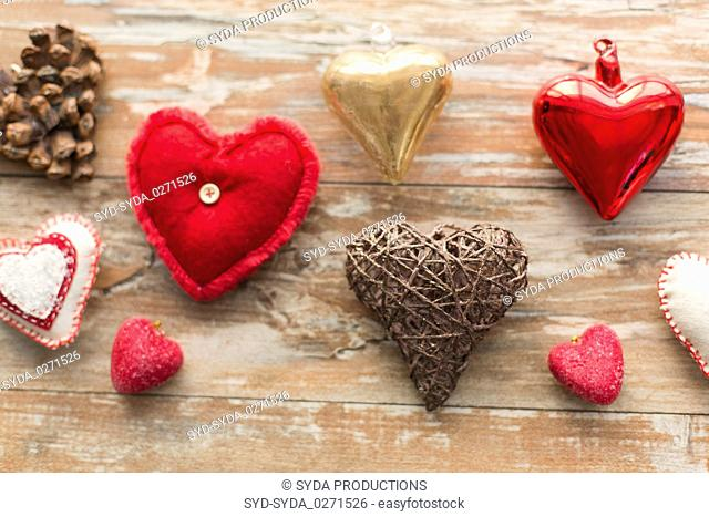 heart shaped decorations on wooden background