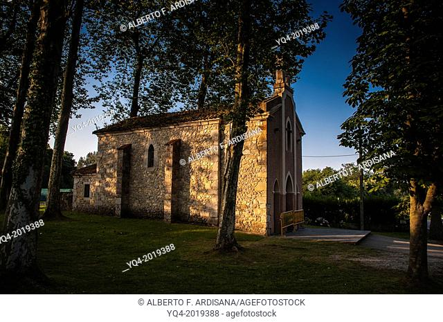 Stone chapel surrounded by trees. Llanes.Asturias. Spain