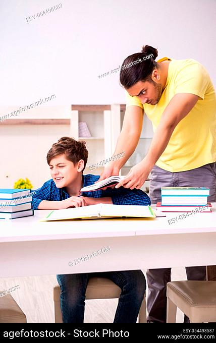 The father helping his son to prepare for school