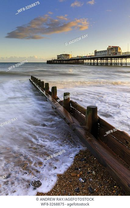 Worthing Pier in West Sussex captured on an afternoon in early March, a long exposure was utilized to blur the movement in a receding wave