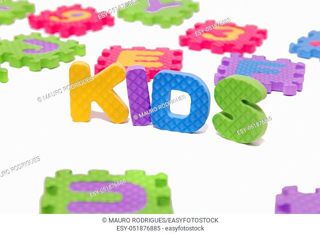 Foam puzzle letter uppercase with word Kids isolated on a white background