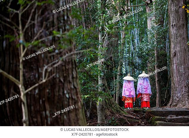 Pilgrims in Heian period costumes, in Daimon-zaka Slope, access at Kumano Nachi Taisha Grand Shire, Kumano Kodo,Nakahechi route, Wakayama, Kinki, Japan