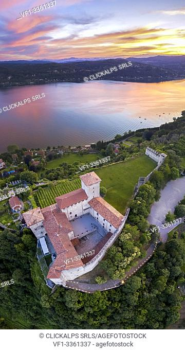 View of the fortress called Rocca di Angera during a spring sunset. Angera, Lake Maggiore, Varese district, Lombardy, Italy