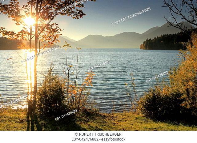 beautiful sundown on a lake in bavaria at autumn
