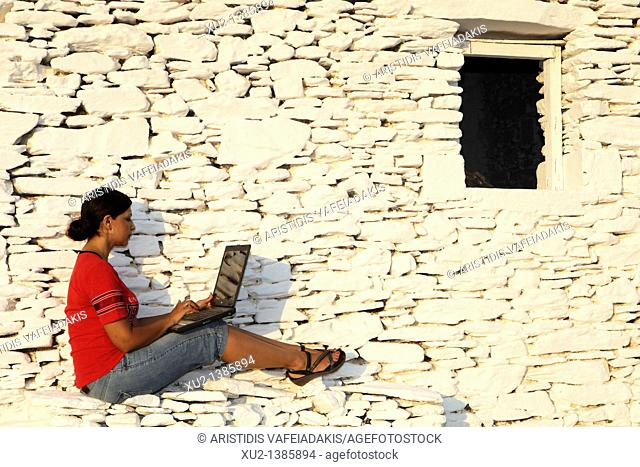 Model with lap top in Kythnos island Greece