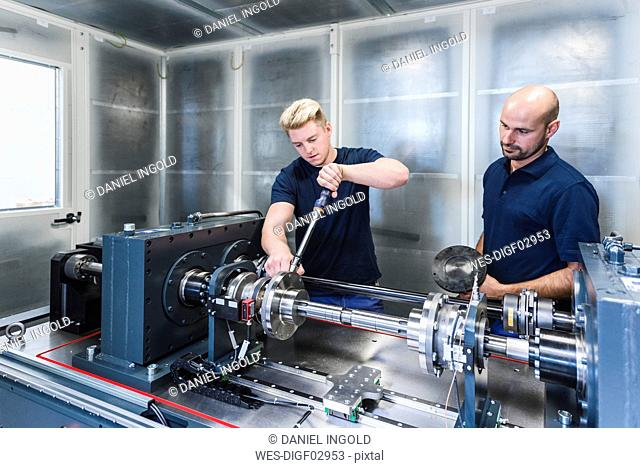 Two colleagues working in modern factory