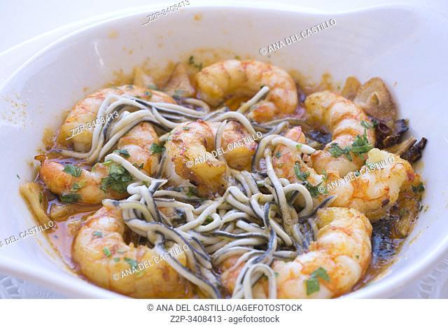 Spanish prawns al ajillo and gulas with garlic and olive oil