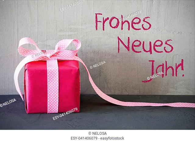 Gray Grungy Cement Wall With German Text Frohes Neues Jahr Means Happy New Year. Pink Gift Or Present With Bow