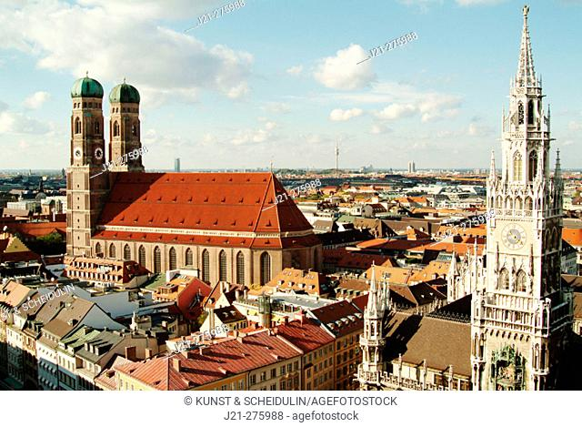 View over Munich from the steeple of Peter's Church (Peterskirche): New Town Hall (Neues Rathaus) on the right, the cathedral Womans's Church (Frauenkirche) on...