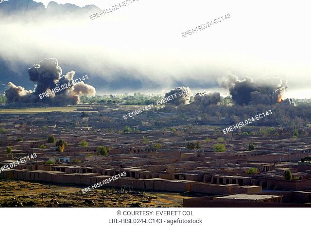 U.S. bombs burst during fighting to retake the village of Now Zad Helmand Province Afghanistan. The village was abandoned in 2006 due to presence of Taliban...