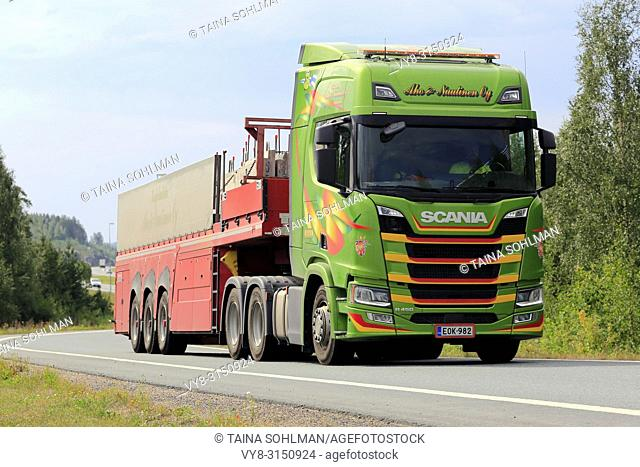 Lempaala, Finland - August 9, 2018: Colourful Next Generation Scania R450 semi trailer hauls concrete slabs on freeway ramp in the summer