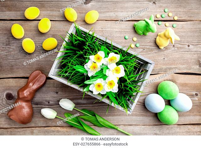 Traditional Easter holiday background with fowers, eggs and bunnies