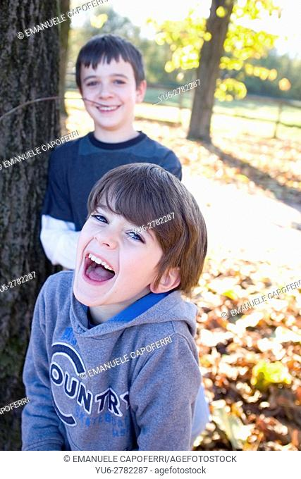Brothers laugh and play outdoors