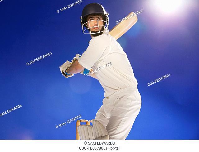 Cricket player holding bat