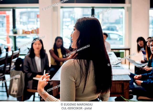 Young businesswoman doing presentation for colleagues