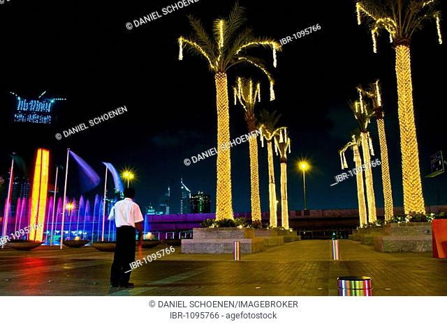 Man working at the carpark in front of the biggest shopping mall worldwide in Dubai, United Arab Emirates, Near East