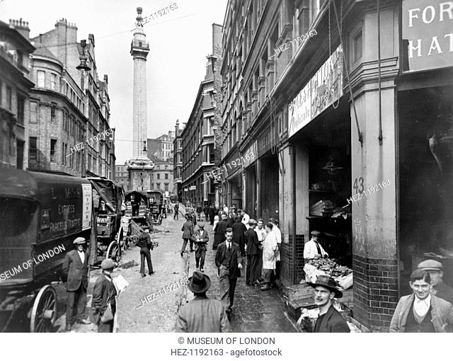 Monument Street and Monument, City of London, before 1933. Reid, an amateur photographer of independent means, began an ambitious project to record