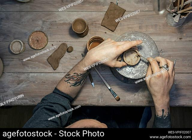 Top view of potter working on workpiece