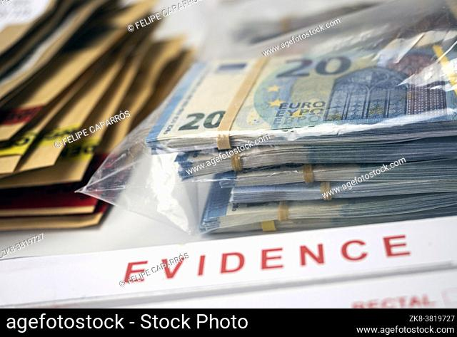 dollar bills in criminal investigation unit, conceptual image