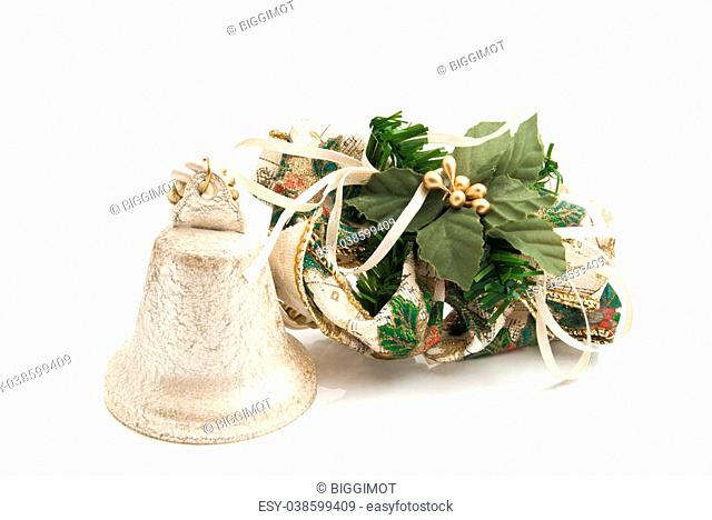 golden Christmas toy bell closeup on white background