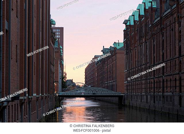 Germany, Hamburg, old warehouse district, canal at sunset