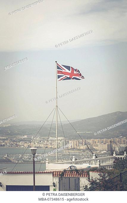 The Union Jack, national flag of the United Kingdom on Gibraltar, view of La Linea de la Concepción on the Spanish mainland
