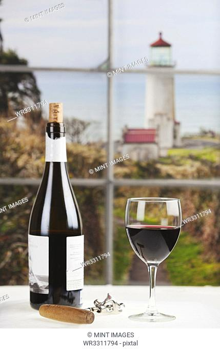 Close up of bottle of wine and glass on table