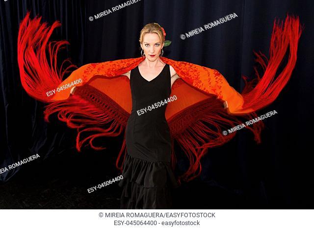 Flamenco dancer waving her red shawl