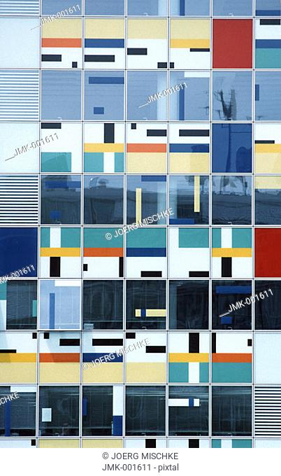 The facade of a modern office block, office building, coloured
