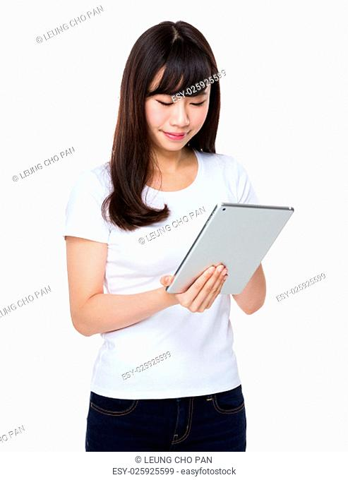 Asian Woman use of the tablet pc