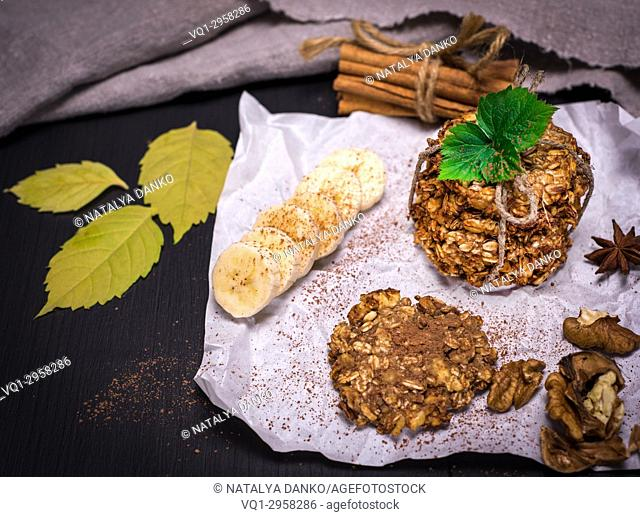 cookies made from oat flakes, nuts and seeds on white paper