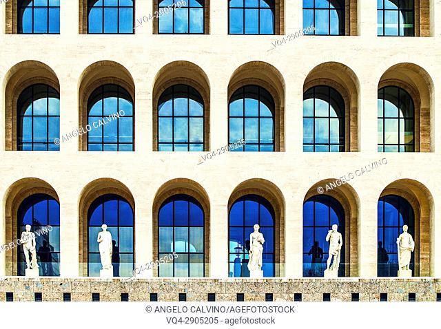 Statues in front of the Facade of Palazzo della Civiltà Italiana, Colosseo Quadrato, EUR, Expo, Rome, Italy, Esposizione Universale