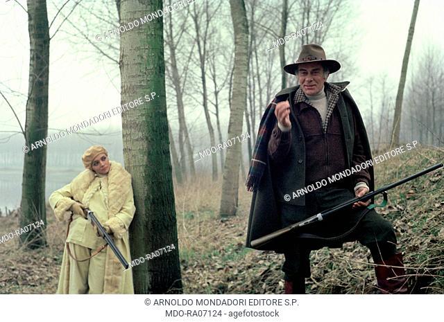 Italian actors Massimo Serato (Giuseppe Segato) and Mara Venier (Mara Provoleri) hunting in the woods in the film Evil Thoughts. 1976