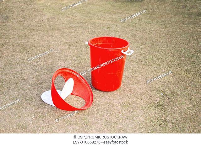 Red dustbin in park