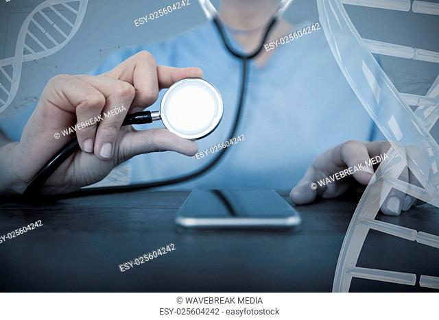 Composite image of midsection of female doctor examining mobile phone with stethoscope