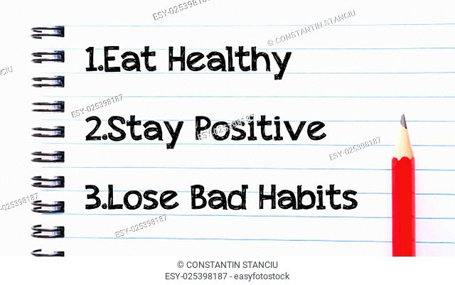 Eat Healthy, Stay Positive, Lose Bad Habits Text written on notebook page, red pencil on the right. Motivational Concept image