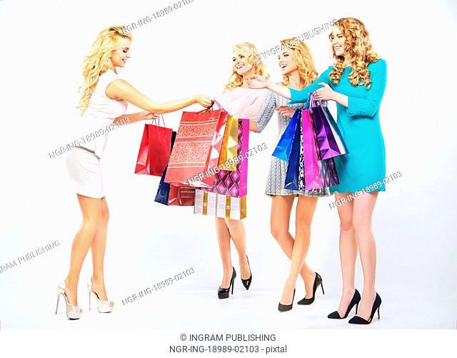 Four beautiful women enjoying the shopping