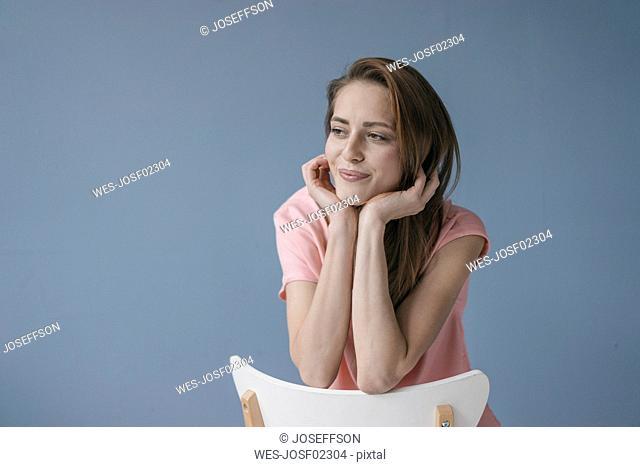 Portrait of a pretty woman, leaning on backrest