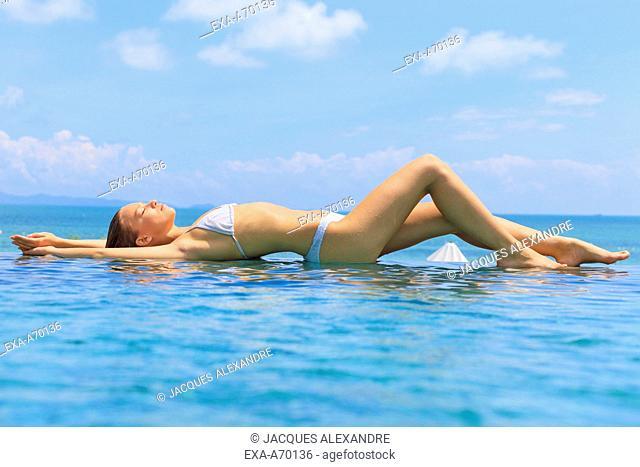 woman lying in swimming pool
