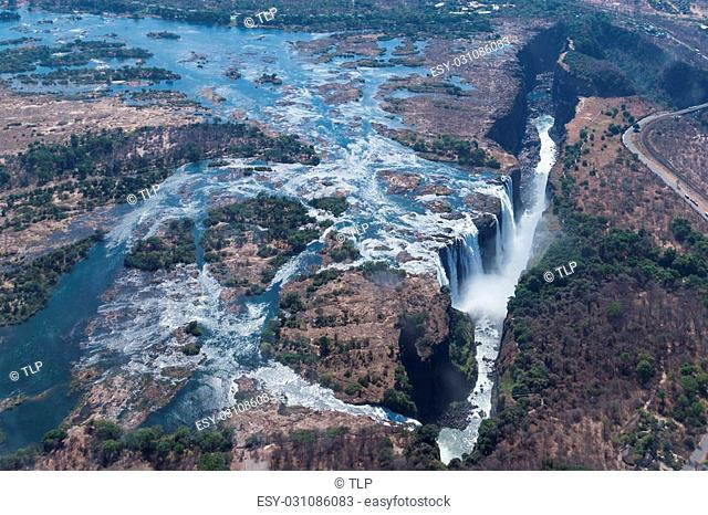 Victoria Falls from above in October. Waterfall running at low speed. Picture taken from helicopter
