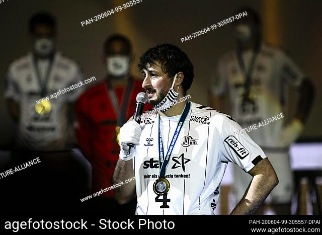 04 June 2020, Schleswig-Holstein, Kiel: The Kiel Domagoj Duvnjak speaks into a microphone. Because of the Corona Pandemic the German handball champion THW Kiel...