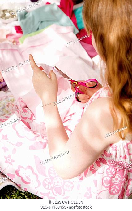 Picture of girl (10-12) cutting fabric