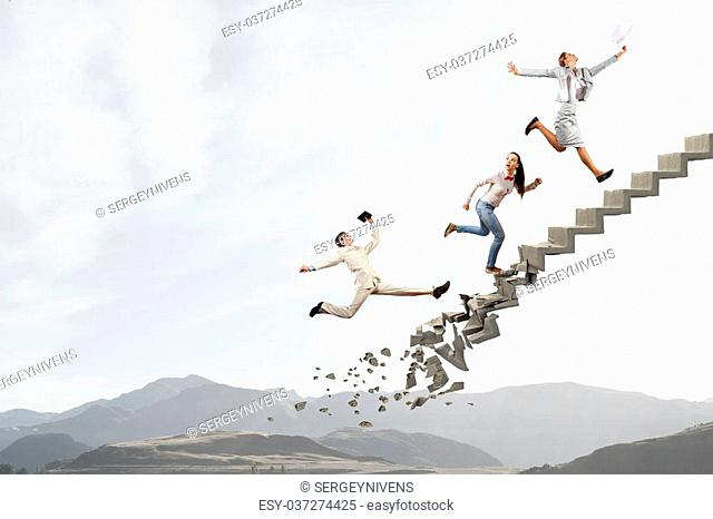 Young businesspeople walking up collapsing staircase representing success concept