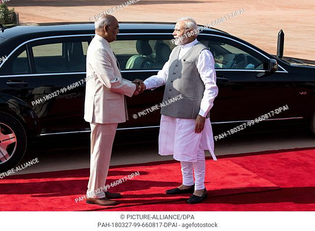 24 March 2018, Germany, New Delhi: The Indian President Ram Nath Kovind and Prime Minister Narendra Modi greet each other in front of an armoured Mercedes Benz...