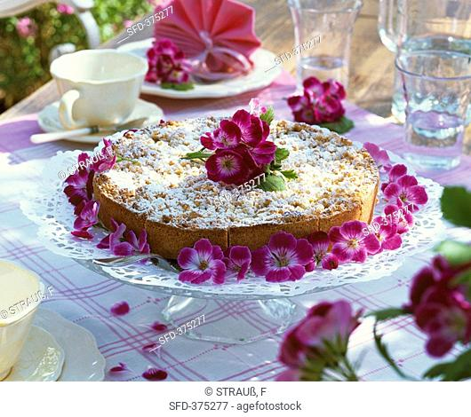 Crumble cake decorated with geranium flowers